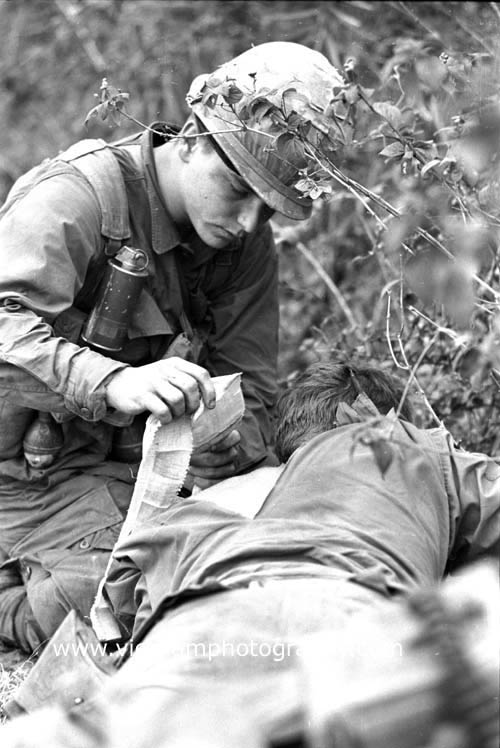 Ision being treated by medic in the central lowlands of vietnam
